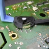 Gently pry the rotor with plastic tools. Careful not to break the SMD resistors.