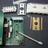 All contact surfaces on both the PCB and elastomeric connectors (zebra strips) should be cleaned with isopropyl alcohol (IPA).