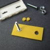 The yellow rubber backing piece needs two holes made to accommodate the screw heads.