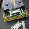 Re-install the PCB assembly and shield.  Say goodbye to the troublesome old plastic bits.