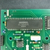 Top half of the upper circuit board. Analog-to-digital converter (ADC) and LCD driver functions are performed by a single 40-pin DIP Intersil ICL7129 device. The LCD assembly is on the opposite side.