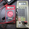 The low-battery annunciator comes on when the battery voltage dips below 7.27V.