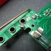The tacked-on input jack PCB.