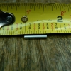 "Cut two lengths of 3/32"" music wire (or steel pin) about 1/2"" long."
