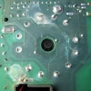 The underside of the PCB and rotary switch. This area sits on top of the piezo element. The diametrically opposed pads near the hole are the piezo contact points.