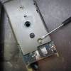 Remove the meter assembly from the plastic case.  Remove the one screw that fastens the top and bottom shield together.