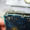 Push the shield up just enough for the backlight connector pins to come out.