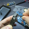 Detach the LCD bezel by prying gently, preferably with a plastic tool.