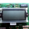 Theres a standard 40-pin DIP 7106 package below the LCD.  The CD4070 is used to drive the decimal points.