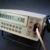 5.000V reference voltage.  More than adequate for Mr. ModemHead's multimeter museum, considering this DMM is capable of revealing the low-cost reference's drift.