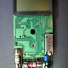 The two boards are held together with four screws surrounding the rotary switch element that is sandwiched in-between.