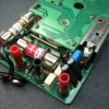 More input protection components include two white plastic-enclosed spark gaps, power resistors and heat-shrinked PTC thermistors.