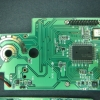 The top circuit board contains the processor and LCD drivers.